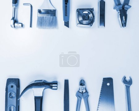 Tools over a white panel