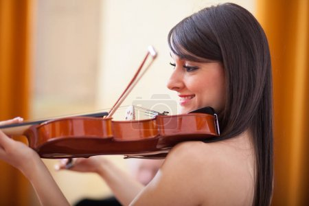 Female musician playing violin