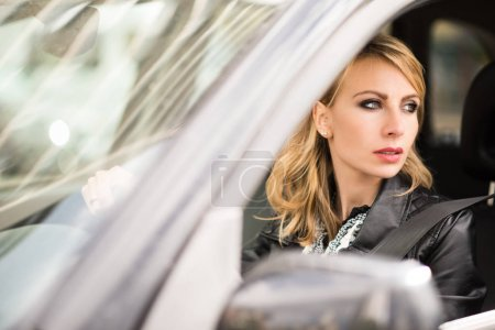 Photo for Attractive Woman driving car - Royalty Free Image