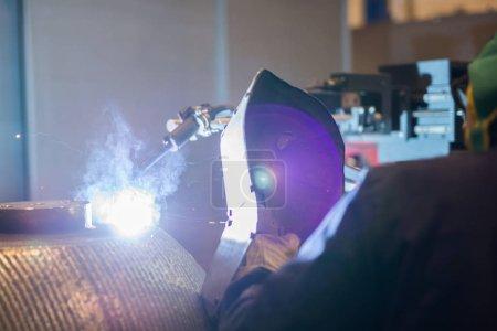 Welder working with Welding Iron