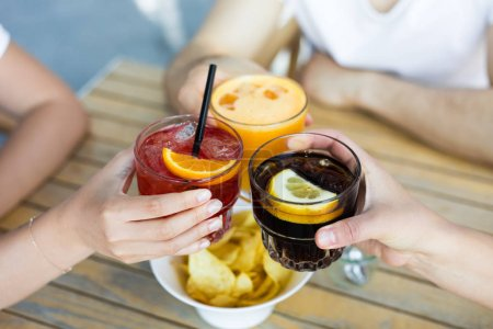 friends having a cocktails together