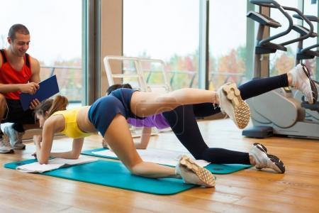 Instructor explaining an exercise to women