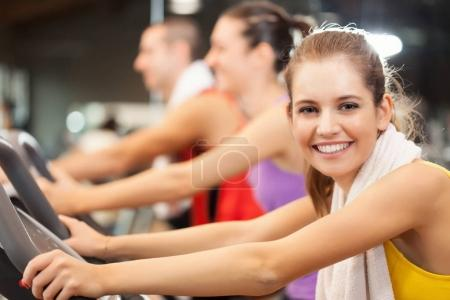 Photo for Portrait of a smiling young woman in a gym - Royalty Free Image