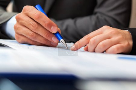 business people working with document