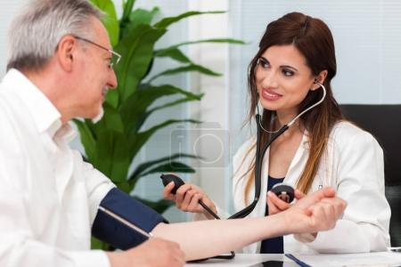 Doctor check blood pressure of patient