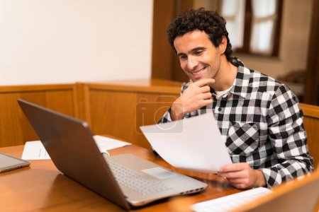 Photo for Man teleworking at home - Royalty Free Image