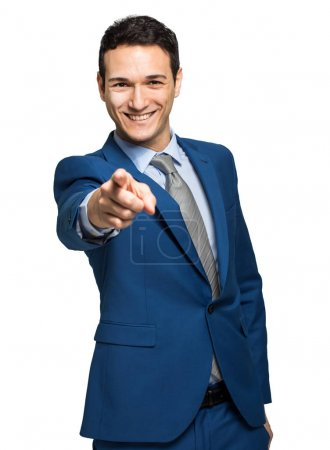 handsome businessman pointing at camera