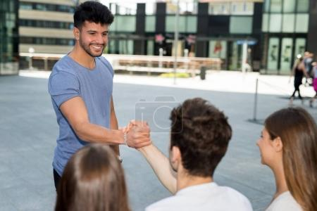 Guy joining group of friends