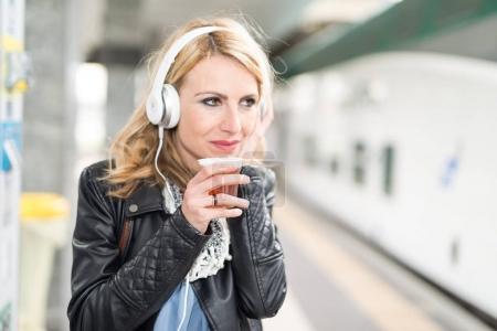 Woman waiting the train