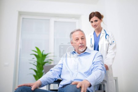 Doctor taking care of a patient on a wheelchair