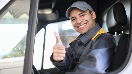Photo for Smiling van driver portrait giving thumbs up - Royalty Free Image