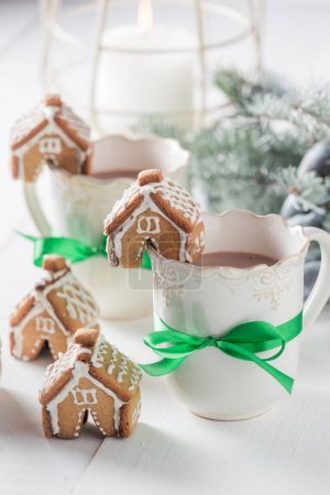 Cute and sweet gingerbread cottages with tasty cocoa for Christmas
