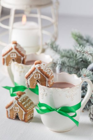 Sweet gingerbread cottages with tasty cocoa for Christmas