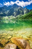 Stunning blue lake in the mountains in sunny day, Poland