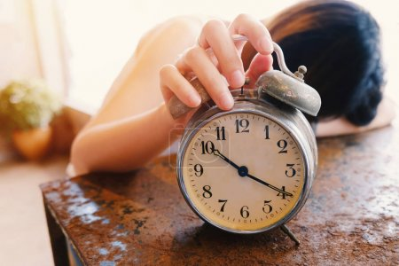 Woman trying to kill alarm clock