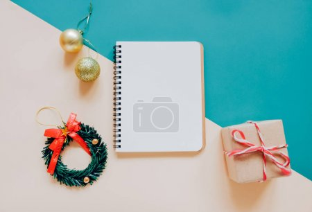 notebook with Christmas ornaments and gift box