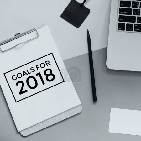 goals for 2018 on clipboard and laptop