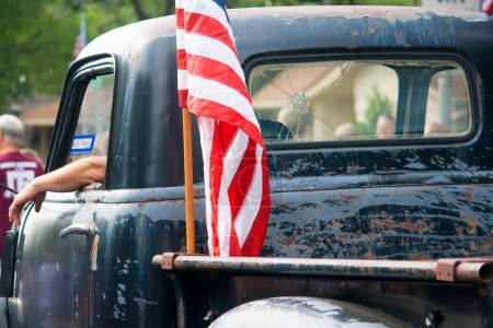 American Flag on Vintage Truck in Fourth of July Parade