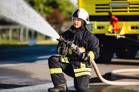 Fireman  spilling water in  combustion zone...