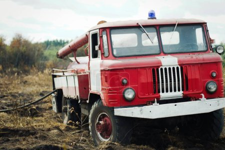 Old fire truck on training in field...