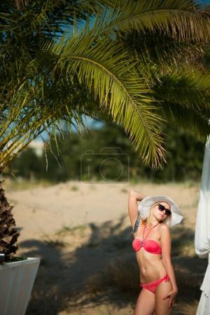 Young sexy tanned woman in bikini