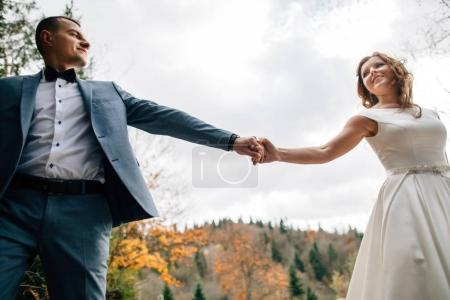 Photo for Beautiful wedding couple walking in the mountains - Royalty Free Image