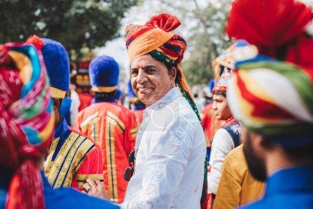 groom on Indian wedding baraat ceremony at Sadar Market, India.