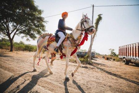 man on horse at Indian Sankranthi (Indian Hindu Festival)