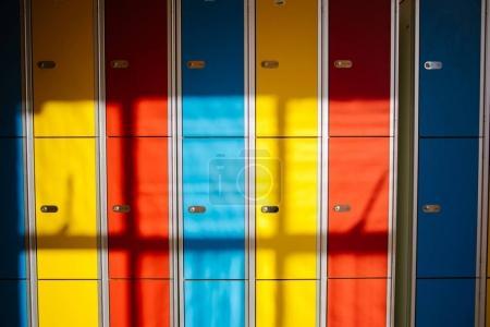 School hallway interior with color student lockers close up