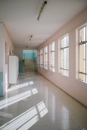 hallway interior with lockers and windows