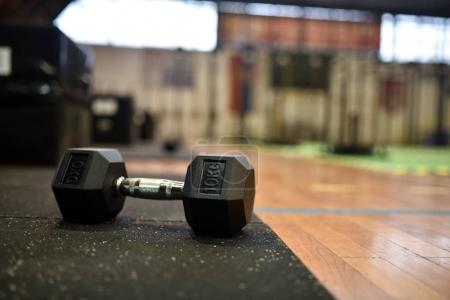 school gym interior with dumbbell close up
