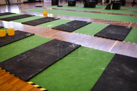 school gym interior with of red weights on mats