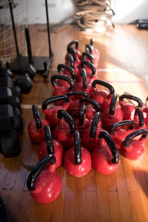 gym interior with stack of red weights on floor