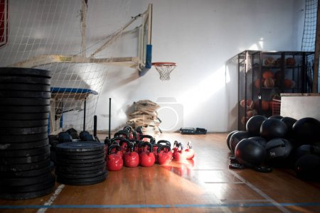 school gym interior with basket and weights