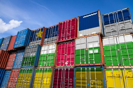 Photo for The national flag of Central African Republic on a large number of metal containers for storing goods stacked in rows on top of each other. Conception of storage of goods by importers, exporters - Royalty Free Image