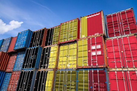 Photo for The national flag of Belgium on a large number of metal containers for storing goods stacked in rows on top of each other. Conception of storage of goods by importers, exporters - Royalty Free Image