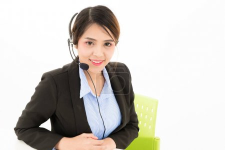 Young attractive confident Asian female business woman in suit b
