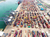 Aerial view of large shipping port with goods cargo containers,