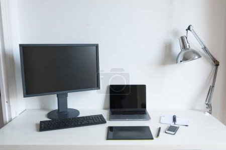 modern desktop computer, laptop, tablet pc on white table, home office concept