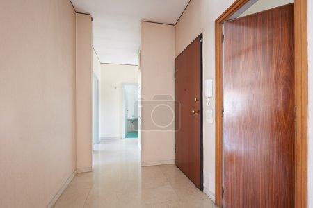 Corridor in empty apartment with marble floor