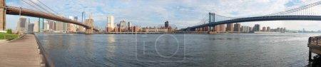 Brooklyn Bridge and Manhattan Bridge panorama with New York skyline