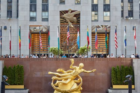 Rockefeller Center with golden Prometheus statue and people in New York
