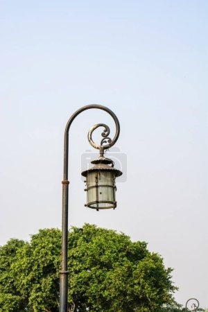 Photo for Old rustic lamp post in the park - Royalty Free Image