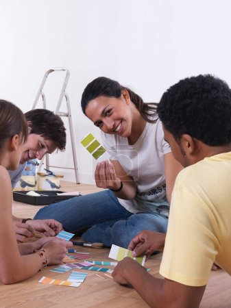 Group of friends choosing paint colours