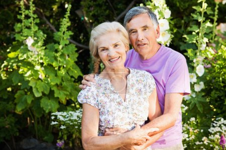 mature couple posing in garden