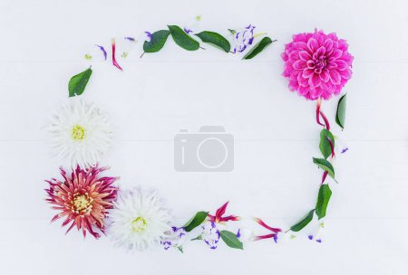 Photo for Frame of flowers with astra peony and leaves. Top view. White background. - Royalty Free Image