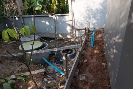 Septic tank and blue pipe install in backyard