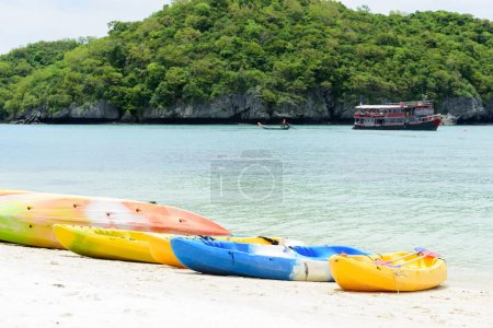 Colorful kayaks on white sand beach in sunny day,Thailand