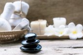 Black zen stones,beauty and skincare products  products on woode
