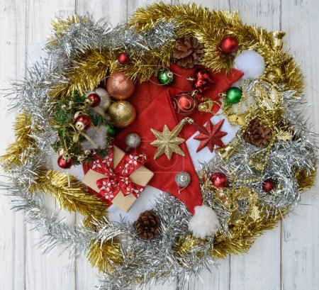 Christmas wreath decorative with gift boxes,star,pine cones on w